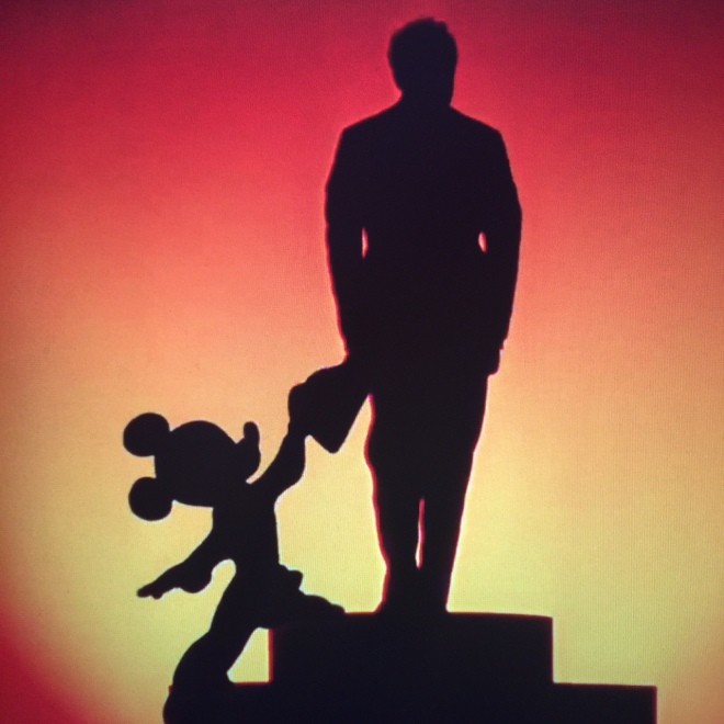 Mickey congratulates conductor Leopold Stokowski, though on what, it isn't super clear.