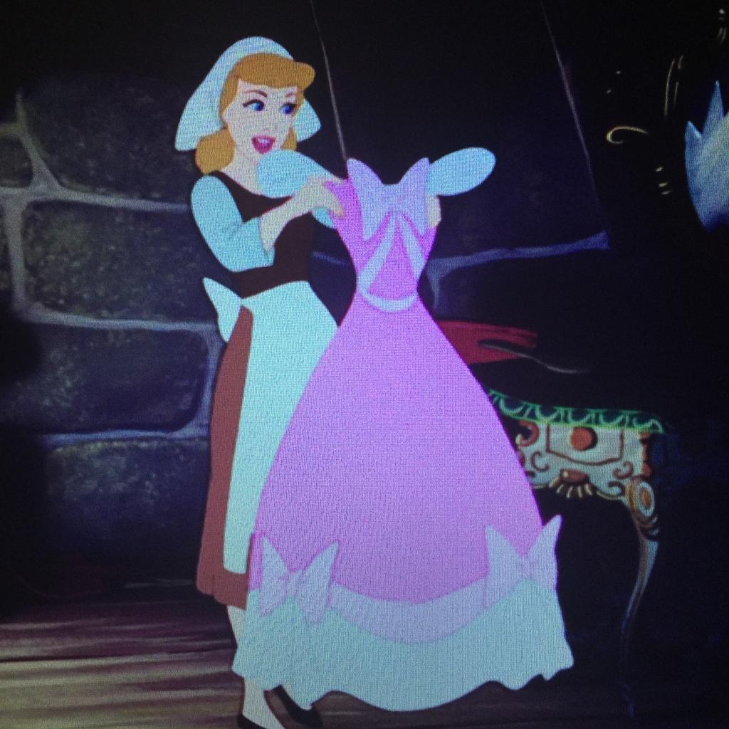 Cinderella admires her mother's dress.