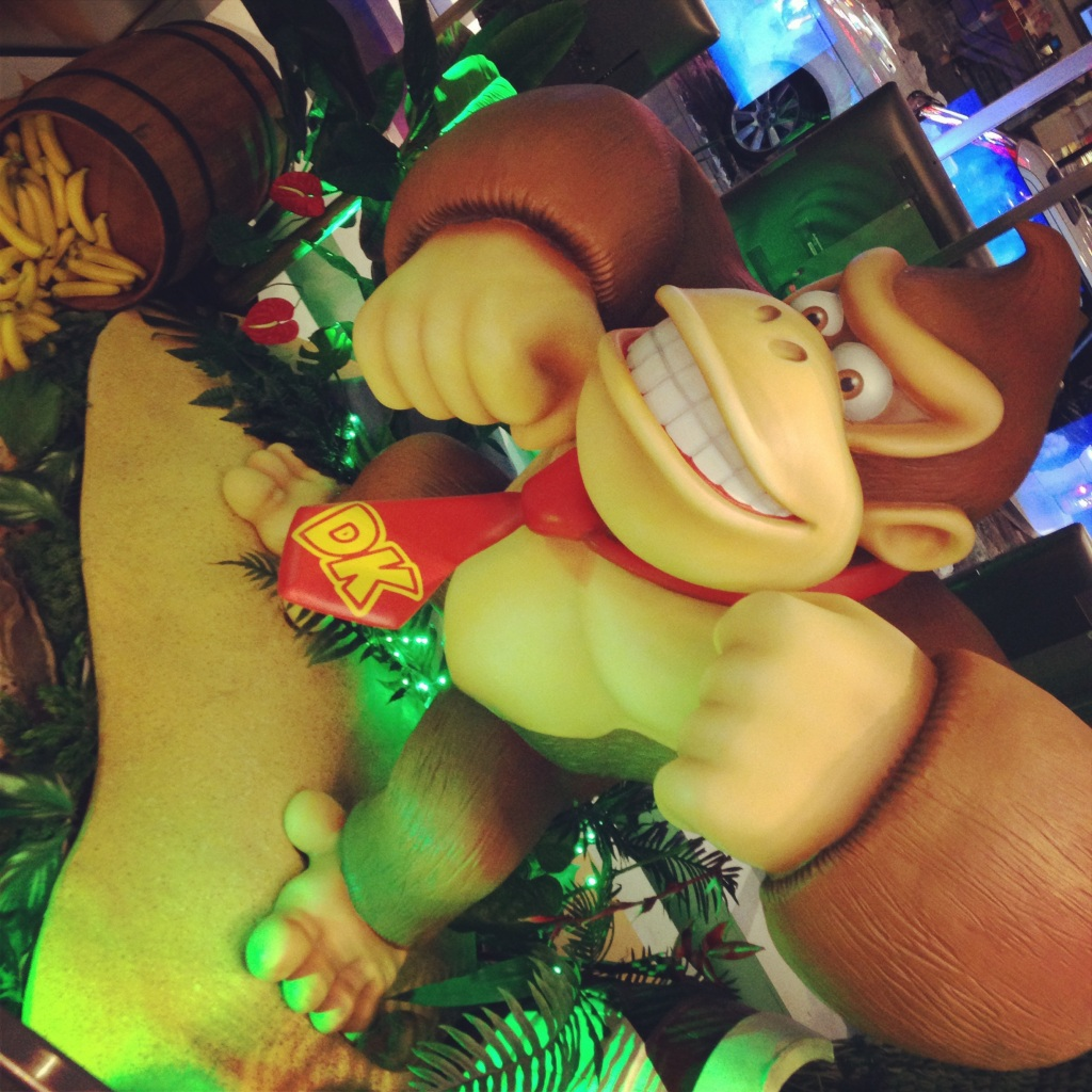 This ape has a funny face. DK.  Donkey Kong is here!