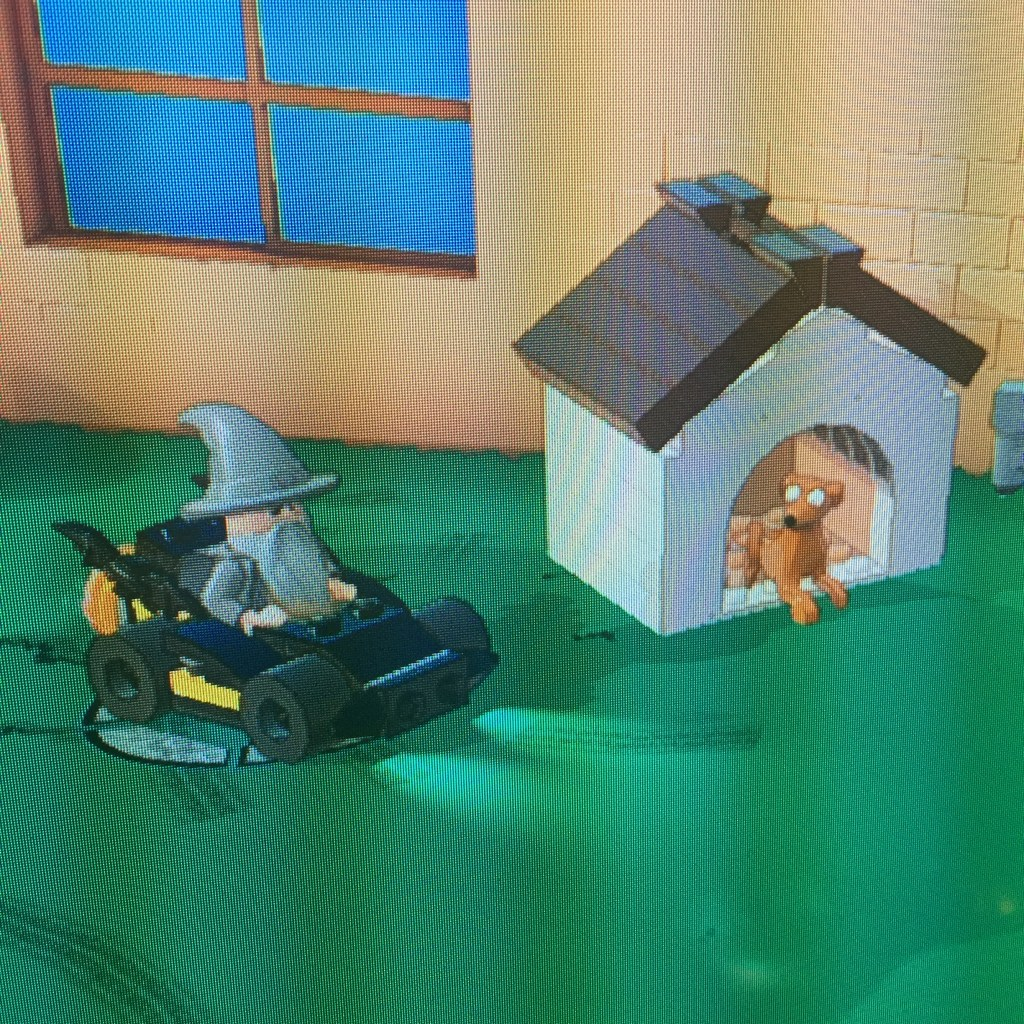 Here we see Gandalf in the Batmobile within The Simpsons world. Hmm, it might be hard to keep all of this straight.